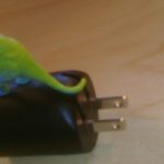 Small Dinosaur on USB Charger
